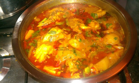 Spicy chicken curry cooked in a thick sauce.