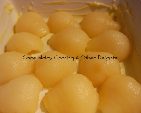 Arrange the pear halves in a greased oven proof dish